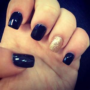 Navy blue and gold sparkle nails nail art