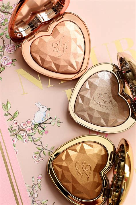 too faced ray of the new too faced love light prismatic highlighters in ray
