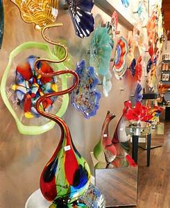 Our unique hand blow glass wall art and vases will add