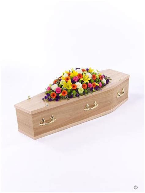 vibrant casket spray ft funeral flowers birmingham