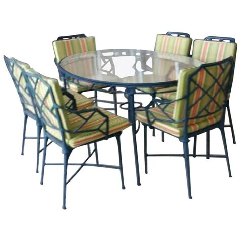 9 pc brown calcutta patio set dining table arm
