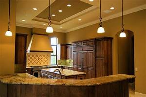 Installing recessed lighting in a kitchen : Electricity recessed lighting installation bigstock
