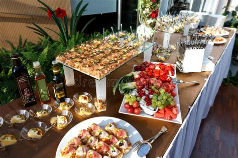 buffet table full  food  small dishes   fruit