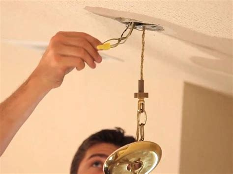 How To Take Chandelier by How To Install A Chandelier Snapguide
