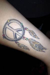 Dreamcatcher, peace sign, rasta colored beads. Tattoo done ...