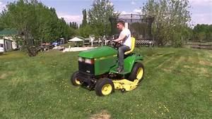 John Deere 425 Mowing