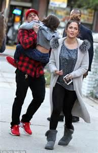 Jennifer Lopez and boyfriend Casper Smart lock hands with ...