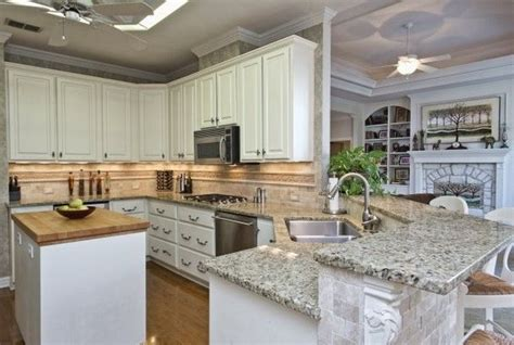 butcher block island with granite countertops kitchen