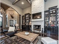 Rustic Living Room with metal fireplace & Box ceiling in