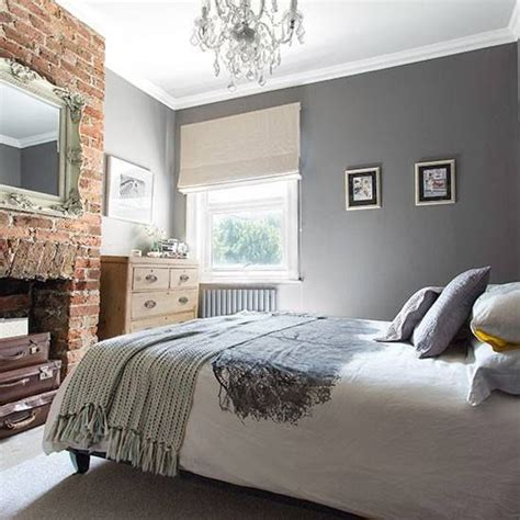 beautiful grey  white bedroom  feature red brick
