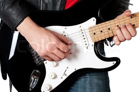 Young Guy In Leather Jacket Playing Electric Guitar On White  Stock Photo Colourbox