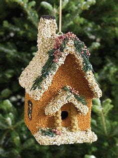 adobe edible birdhouse a bird seed covered birdhouse in
