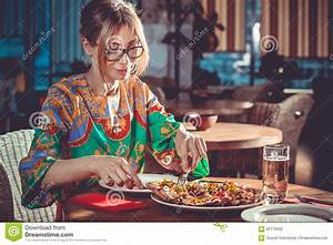 Woman eating at restaurant stock photo. Image of attractive - 62170522