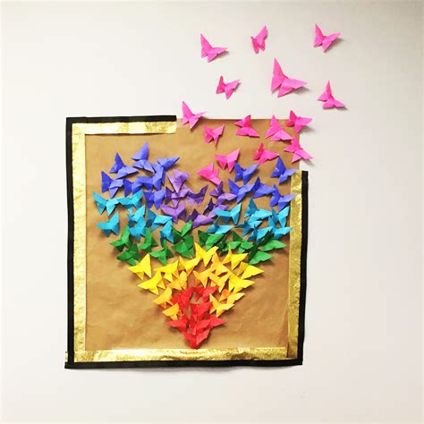 Choose colorful paper and let them draw, cut, and then arrange the butterfly on the wall. Paper Butterfly Heart Wall Art