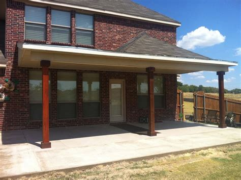 Painted, Shingled Patio Cover Ties In To Brick Wall In