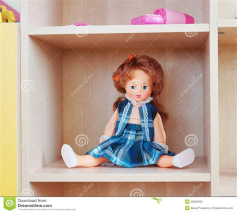 on the shelf doll doll on a shelf royalty free stock photos image 28826358