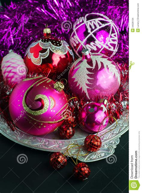 red and pink christmas decorations stock photo image