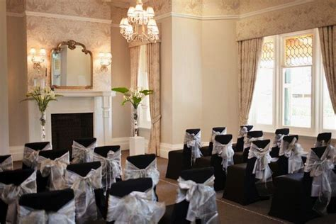 black chair covers with silver sash bows partridge house