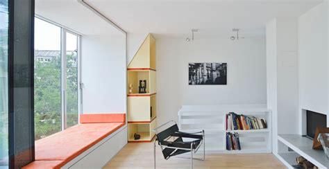 wohnzimmer contemporary family room dusseldorf by wohnzimmer mit sitznische und kamin im 3 obergeschoss
