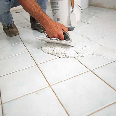 video  shows    grout  tiling  floor