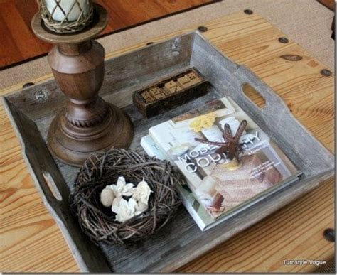 A coffee table just takes up so much real estate, and that space can be used for sprawling out with a board game or giving the kids room to frolic. Ottoman Coffee Table Trays and Styling - Videos and Tutorial-Decorated Life
