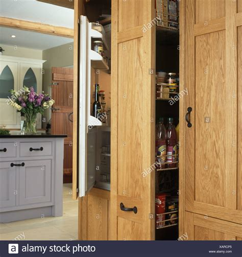 Pull Out Cupboard by Pull Out Larder Storage Cupboard Beside Refrigerator With