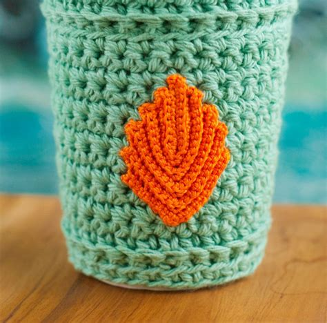 This is a tutorial/pattern for a crocheted coffee mug cozy! Coffee cozy cup sleeve crochet in turquoise and orange