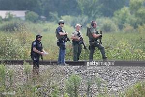 The Latest: Police Hunt for 3 Suspects After Officer ...
