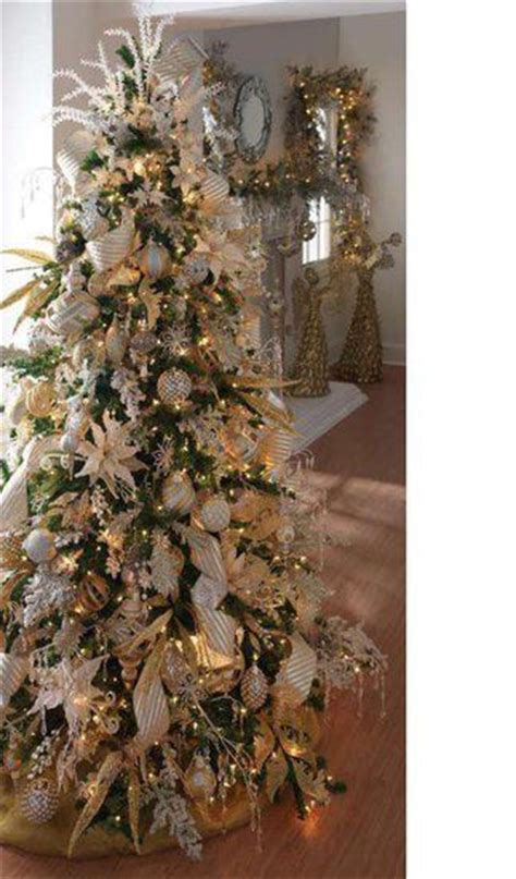 white tree with gold decorations white and gold trees