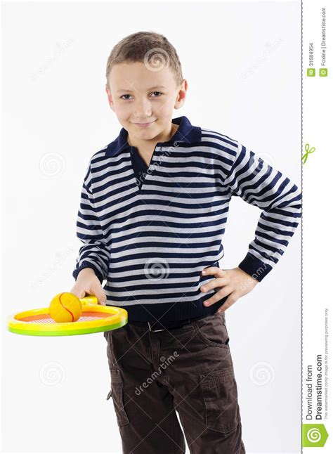 A city kid is brought to the countryside by his father's new coaching gig: Boy with a tennis racket stock photo. Image of leisure - 31684954