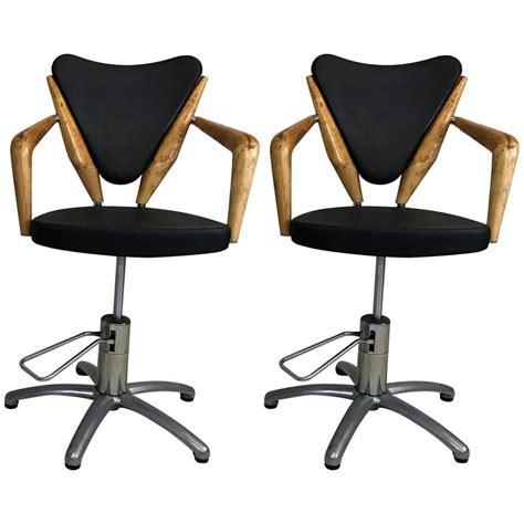 pair of mid century european hydraulic salon chairs