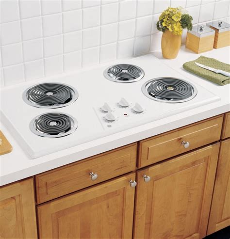 ge jpwkww  electric cooktop   coil elements removable drip bowls upfront controls