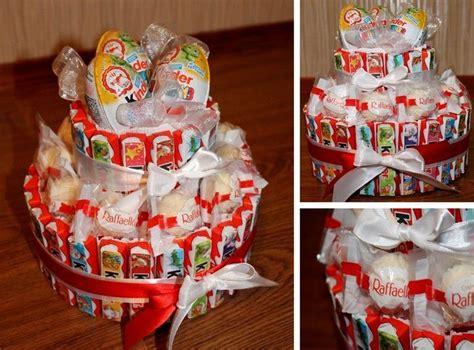 torte aus kinderriegeln sch 246 ne torte in wei 223 und rot aus kinderriegeln raffaello pralinen und 220 eiern geschenkidee