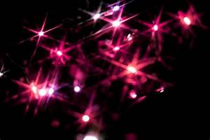 Christmas Background Pink Photo Of Christmas Background Of Pink Starburst Lights