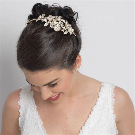 ivory flower rhinestone side accented gold headband