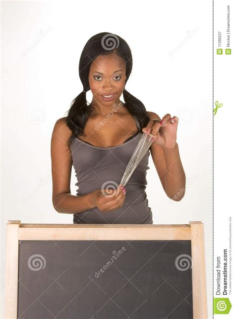 african american woman with condom by blackboard royalty