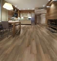 vinyl flooring vs laminate flooring a full comparison