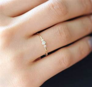 Three stone round brilliant cut diamond engagement ring for Tiny wedding ring