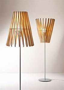39stick lamp39 line by matali crasset fuses light and shadow for Wood stick floor lamp