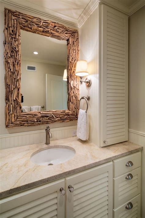 coastal guest bathroom  driftwood mirror hgtv