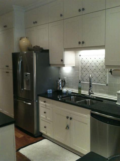 Galley Kitchen Layouts Ideas - stove backsplash stove and condo kitchen on pinterest