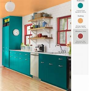 Teal and red yellow orange kitchen teal cabinets red for Kitchen cabinets lowes with teal and orange wall art