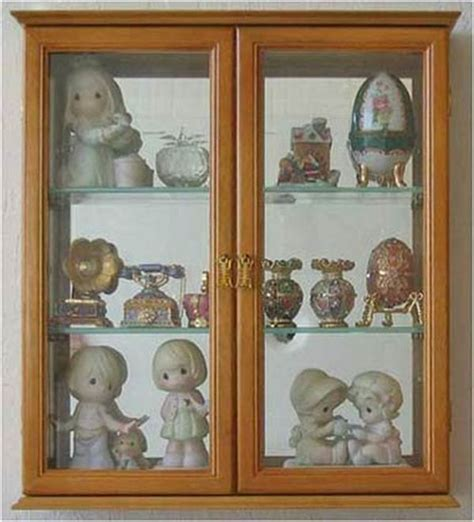 decorative wall curio cabinets wall mounted curio cabinet with glass doors to reveal the