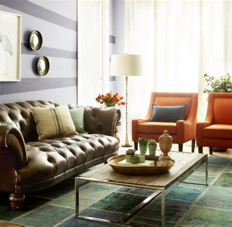 love  mismatched living room seating   orange