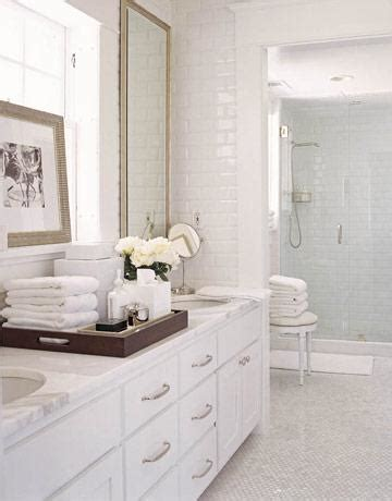 white vanity with white marble countertop
