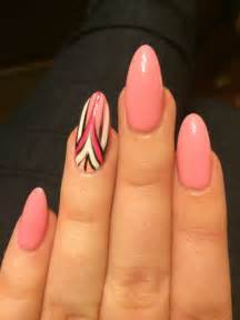 Design in white pink coral and black acrylic nails done pointy more