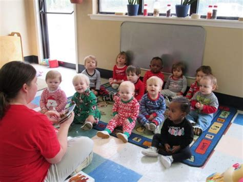 cadence academy preschool harbison in columbia sc 452 | toddler teacher reading book at cadence academy preschool harbison columbia sc 600x450