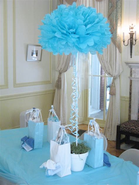 simple baby shower decorations baby shower centerpiece topiary tissue flower stuck into 1 2 rd of florist s foam dowel goes
