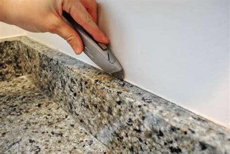 Caulking Kitchen Backsplash by Removing The Side Splash Backsplash From Our Bathroom