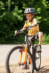 Kid riding bicycle | Stock Photo | Colourbox